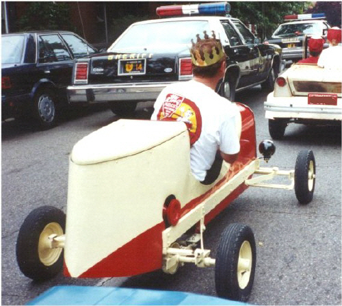 Man driving a King Midget Model I