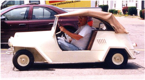 Man Driving a White King Midget Model II